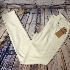 """TRUE RELIGION HALLE SUPER SKINNY MID-RISE JEANS Great price on these AUTHENTIC TRUE RELIGION JEANS.THEY ARE WINTER WHITE WITH A PANEL DOWN EACH LEG.. Retail $248 WILL MATCH ANYTHING YOUR HEART DESIRES.. 30"""" inseam❌BUNDLE THESE WITH 2 MORE ITEMS FOR A GREAT DISCOUNT❌ True Religion Jeans Skinny"""