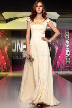 traditional champagne satin evening dress with boat neckline and beaded low back