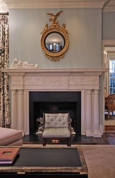 Federal Design- This federal fireplace is very professional and the classic eagle on top of the mirror gives that federal feel. Also the columns that you can see in the fire place are very formal.
