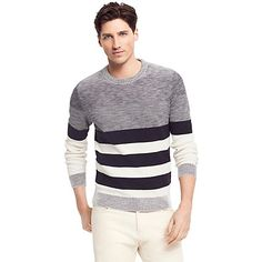 Tommy Hilfiger men's sweater. A few well-placed stripes give the illusion you've spent hours at the gym rather than team bonding at happy hour (we won't tell). Besides making you look good, this sweater feels great in premium cotton that fits snug where it you need it, looser where you don't. • Classic fit.• 100% cotton. • Crewneck, ribbed trim, microflag at cuff.• Machine washable. • Imported.