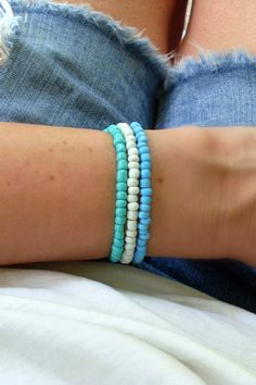 Stay in the Summer state of mind all year with these Ocean Blue bracelet stacks. Create your Vibe at jaycimay.com.    #jaycimay #summer #goodvibes #blue Beachy Bracelets, Summer Bracelets, Seed Bead Bracelets, Colorful Bracelets, Handmade Bracelets, Friendship Bracelets, Seed Beads, Name Bracelet, White Beads