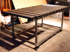 Welding table with steel 2x3 rectangular tubing. With round tubes through the ends as the base of the top?