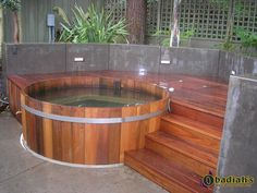 Northern Lights cedar hot tub integrated in a pation with easy access from the raised deck. Hot Tub Deck, Hot Tub Backyard, Hot Tub Garden, Jacuzzi, Whirlpool Deck, Outdoor Shower Enclosure, Outdoor Showers, Pergola, Tub Enclosures