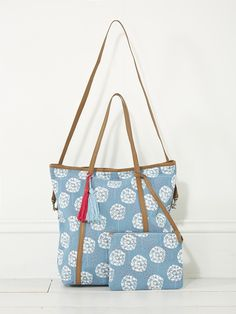 This clever tote can be worn as a shopper or a shoulder bag with a removable leather strap and genuine leather handles and trims. Inside there's pop-coloured lining and a brilliant removable pouch in the same pretty floral print.