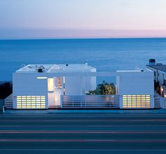 This home is located right on the beach with an amazing view of the ocean.  Richard Meier is one of the most talented architects, and anyone that appreciates modern architecture will definitely find this home to be visually stunning. The bright white exterior looks so simple, but there are so many intricate details.
