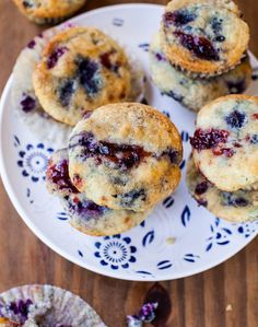 We want a plate of these with a cup of coffee- Blueberry Muffins with Raspberry Jam Swirls