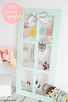 Old french window and some chicken wire make a perfect earring display unit