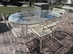 iron patio round table and chairs glass top seat bottoms removed