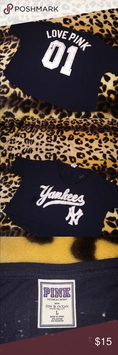 Victoria's Secret pink Yankees baseball half shirt Victoria's Secret pink navy blue with white glittered lettering New York Yankees baseball half shirt. This is a belly shirt. Size large.  I am open to reasonable offers. 15% bundle discount on 3 or more items. Smoke free home. Happy poshing!  PINK Victoria's Secret Tops Tees - Short Sleeve