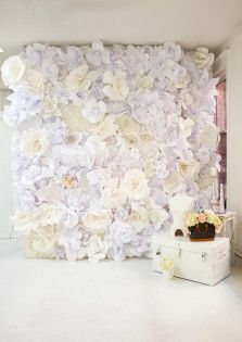 A beautiful backdrop of paper flowers is not only inexpensive, but impressive as well. Here are the top ten DIY Paper Flower Backdrop tutorials on the web.