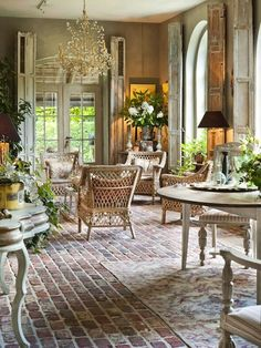 I love the feel of this garden room for the epicure in the centre of the longere.... chic and classic... the original tiles and exposed timbers should work well against Lloyd loom style garden furniture