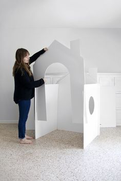 a Collapsible Playhouse Make a collapsible playhouse out of cardboard, foamboard, or masonite.Make a collapsible playhouse out of cardboard, foamboard, or masonite. Cardboard Houses For Kids, Cardboard Playhouse, Build A Playhouse, Cardboard Crafts, Cardboard Castle, Cardboard Furniture, Kids Furniture, Diy Toys, Cubbies