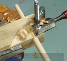 Dowel Maker - Homemade dowel maker consisting of a maple block drilled to the desired dowel size. The dowel blank is fashioned from square stock on a table saw, then mounted in a drill, spun in the predrilled hole, and shaped to its final contour by a wood chisel clamped to the maple block.