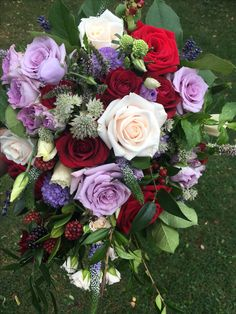 Hand tied trailing bouquet of mauve red and cream flowers Trailing Bouquet, September Wedding Flowers, Cream Flowers, Seasonal Flowers, Mauve, Floral Wreath, Wreaths, Seasons, Rose