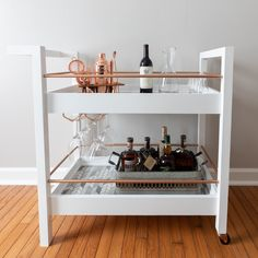 Free woodworking plans for a DIY bar cart. This elegant bar cart incorporates marble tile and rose gold accents. Build this bar cart today!