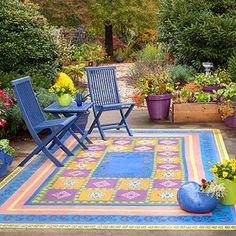 Paint a faux concrete rug on outdoor patio - do not like these colors but something in a modern understated tones, pattern could be cool???