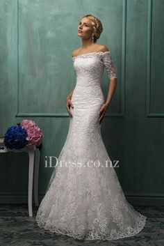 two-piece strapless lace overlay mermaid wedding gown with detachable off shoulder sheer lace jacket