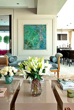 feminine living room with abstract art, a fainting couch & murano glass vases