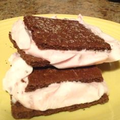 Mix together one cup of your favorite flavor Greek yogurt (I use dark cherry) and a cup of cool whip free. Spread between two chocolate graham crackers and freeze in tin foil. A few hours later, you'll have homemade ice cream sandwiches that are only 1 weight watchers point! They are SO good!