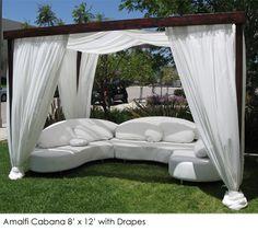 another cabana. love the dark wood + white fabric.