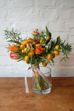 Rosemary and kumquats are the perfect pair when added to bouquets and boutonnieres of citrus-colored ranunculus, leaving marvelously subtle smells in their wake. Floral Bouquets, Wedding Bouquets, Wedding Flowers, Tulip Bouquet, Herb Bouquet, Bouquet Flowers, Winter Floral Arrangements, Flower Arrangements, Table Arrangements