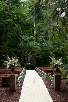 A forest wedding, with rustic benches. This is particularly gorgeous. I would leave out the clear vases though as I think they are distracting.... I WANT TO BE OUTDOORS!!