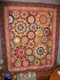 Nancy Austin Swanwick Millefiori quilt - amazing! Start really make it pop - note they're all a very dark color (black?)