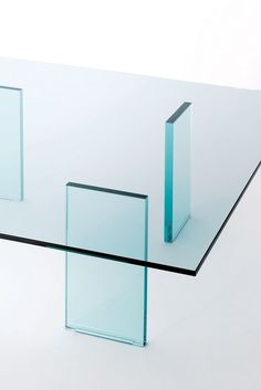 GLASS TABLE design Shiro Kuramata   Low table characterised by the very refined minimal aspect with feet in mm. 24 thick transparent glass, thermo-welded to the top in mm. 12 thick transparent tempered glass. Historical and iconic product of the international design, designed in 1976 by the great master Shiro Kuramata.