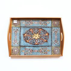 Wooden tray features folk art style hand-painting on glass inset. In reverse glass painting, the design is silk screened onto the reverse side of the glass. / fair trade hand painted tray from Peru