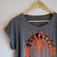 Embellished, patterned Women's T-SHIRT with an ornate, jEWEL INSPIRED print, ghanaian printed fabric appliqué panels and vinyl jewels. Applique Fabric, Organic Cotton T Shirts, Baby Wearing, Printed Cotton, Printing On Fabric, Renewable Energy, T Shirts For Women, Sweatshirts, Pattern