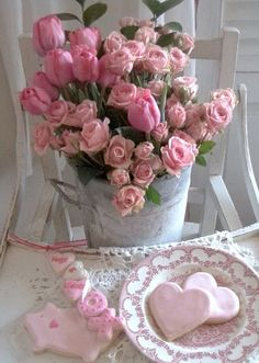 Another cute bucket of roses sitting in an old high chair.