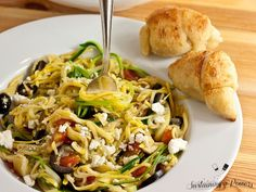 Greek Zucchini Noodles recipe with Feta, Olives, Artichokes and Tomatoes.
