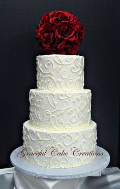 Elegant White Buttercream Wedding Cake. I like the scrollwork and then sunflower on top.