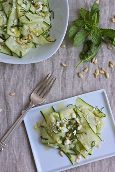 This delicious summer salad combines thin ribbons of zucchini with toasted pine nuts, fresh mint and salty feta. I feel like I've been all over the map this week. One day I'm walking through the Greenmarket, like a kid in Clean Eating Recipes, Raw Food Recipes, Salad Recipes, Healthy Recipes, Healthy Food, Veggie Side Dishes, Main Dishes, Zucchini Ribbon Salad, Summer Salads