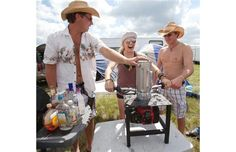 Bree Garska (centre) from Glendon, Alta. operates a 50 c.c. two-stroke gas engine drink blender with the help of Curtis Wentz, left, and Shawn Ingersoll from Cold Lake, Alta. on the camp grounds at the Big Valley Jamboree.