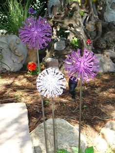 Screws in a golf ball on metal rod and spray painted to look like Allium flowers.