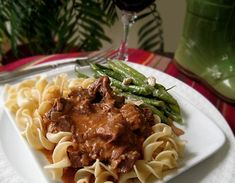 This is a traditional Hungarian beef dish served over buttered noodles for a hearty, satisfying meal. The amounts of garlic, onions, and especially paprika may seem excessive, but they all melt into an incredibly rich and flavorful pan gravy during the slow cooking process. The sauce is further enriched by the addition of sour cream. (Have not made yet.)