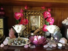 Lovely lotus candle holder with flowers and artwork in meditation space