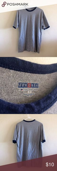 Gray T shirt with blue rims Pre-owned & in good condition. 80% cotton, 20% polyester. Shirts Tees - Short Sleeve