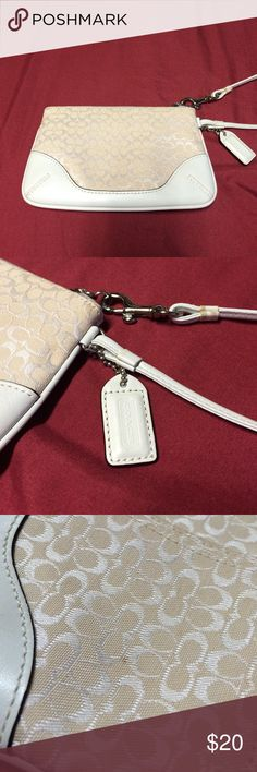 Coach Wristlet White/ Off-white Coach Wristlet. Small spot on one side (see pic), but it's not too noticeable. Coach Bags Clutches & Wristlets