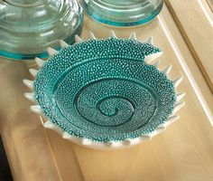 Warm ocean tides lit by the tropical sun inspired the color of this fantastic decorative dish. The swirling, textured pattern of the dish's interior is a tribute to the equally beautiful and strong sh