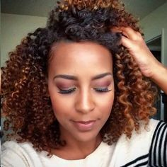 Love her beautiful natural hair and the color too!