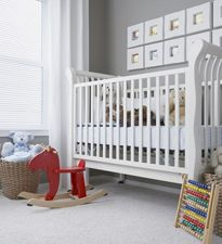 Nursery with neutral colors www.thebump.com