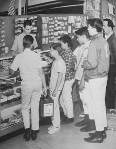 Young slot car racers line up at their favorite slot car hobby shop counter to purchase the latest accessories to make their slot cars that much faster.