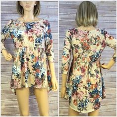 """NWT Floral Mini High/Low Dress/Tunic Size L NWT and made in the USA! Size large. This gorgeous mini high/low dress/tunic is perfect for spring. Approximately 31"""" long from shoulder to lowest hemline. 17"""" arm pit to arm pit. 95% polyester, 5% spandex so it has some stretch. Smoke free home. Dresses High Low"""