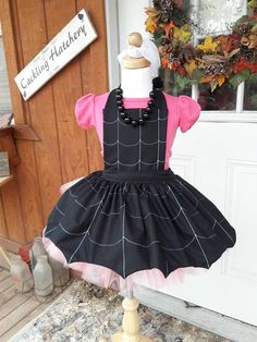This is the new kid in town Vampira. shes so cute in her little black dress so I have decided to make an apron looking like her little black dress. my apron has webbing that is sewn on the black fabric, The bottom of the apron has a little points. THE TUTU, AND SHIRT, NECKLESS IS