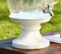 Use cake stand to raise decanters. This one is made specifically for them by Pottery Barn, but we could improvise!