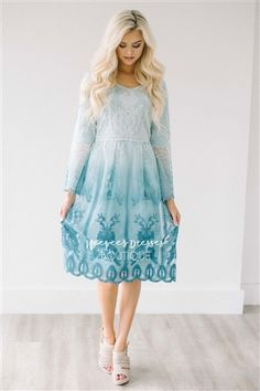Our best selling dress is back in this beautiful ombre lace!! Our Day Dreamer dress is fully lined, has long sleeves, a relaxed fit and the overlay is an ombre Caribbean blue color.