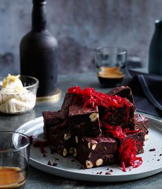 Beetroot brownies with ginger crème fraîche/150 gmhazelnuts 450 gmcaster sugar 4eggs, at room temperature 170 gmplain flour 115 gmDutch-process cocoa powder, sieved 250 gmbutter, melted Seedsscraped from 1 vanilla bean 200 gmgrated beetroot, plus extra to serve 400 gmdark chocolate (66% cocoa solids), finely chopped  Ginger crème fraîche150 gmcrème fraîche 10 gmglacé ginger, thinly sliced Seedsscraped from ¼ vanilla bean