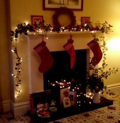 Our fireplace - Ivy, Holly, occasional baubles and fairy lights